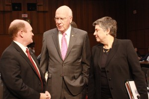 Sens. Christopher Coons (l) and Patrick Leahy speak to Department of Homeland Security secretary Janet Napolitano ahead of her testimony before the Judiciary Committee. (Nadya Faulx/MNS)