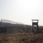One of the many watchtowers looming over the now defunct Camp X-Ray. The camp was originally used to hold troublesome refugees in the early 1990s and was repurposed in 2001 to hold detainees in support of the War on Terror.