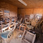Dusty chairs are piled in what was once one of the interrogation rooms at Camp X-Ray. The camp was originally used to hold troublesome refugees in the early 1990s and was repurposed in 2001 to hold detainees in support of the War on Terror.