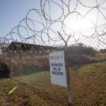 The sign outside the now defunct Camp X-Ray reminds visitors that it is off limits. The camp was originally used to hold troublesome refugees in the early 1990s and was repurposed in 2001 to hold detainees in support of the War on Terror.