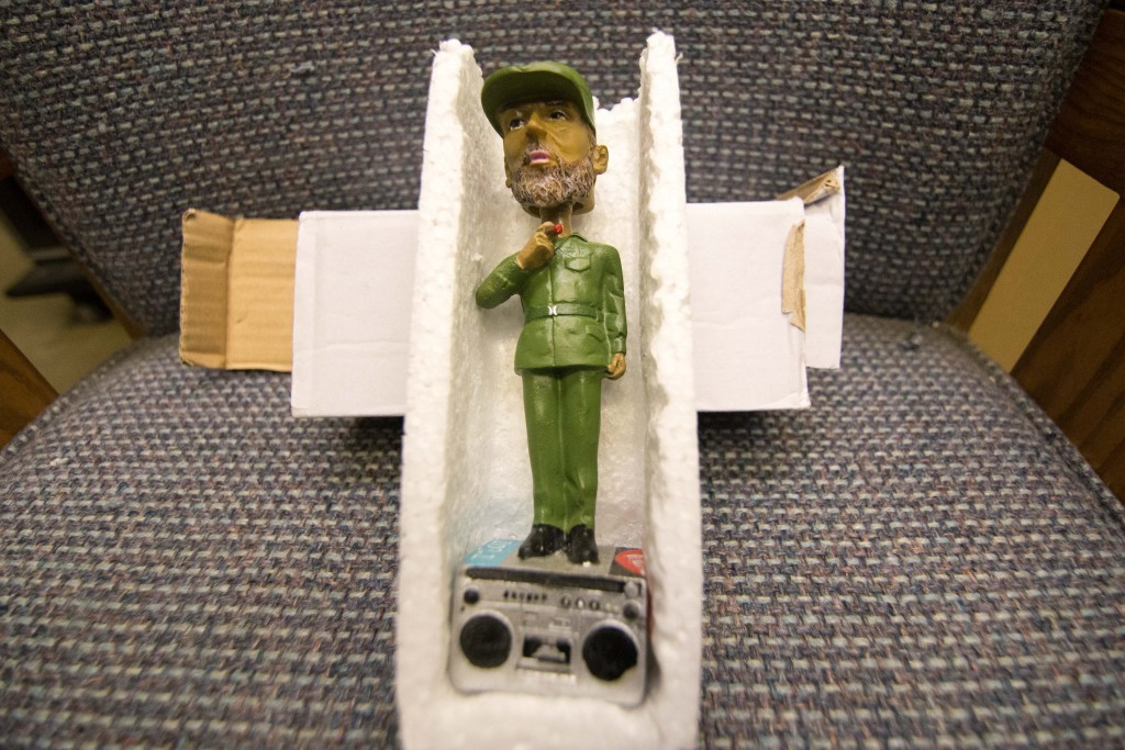"""Radio GTMO sells Fidel Castro bobble heads for $25 a piece. On the base is a sticker with the radio station's maxim: """"rockin' in Fidels's backyard."""""""