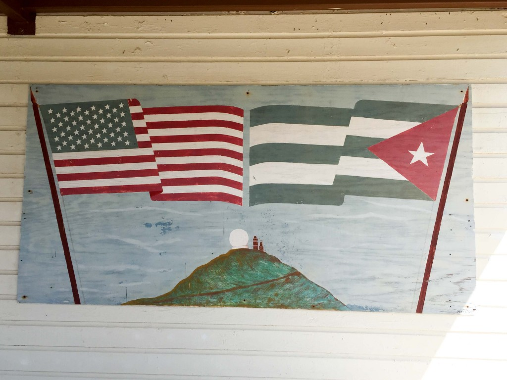 A painted mural of the American and Cuban flags near the lighthouse in Guantanamo Bay, Cuba (Ezra Kaplan/MNS)