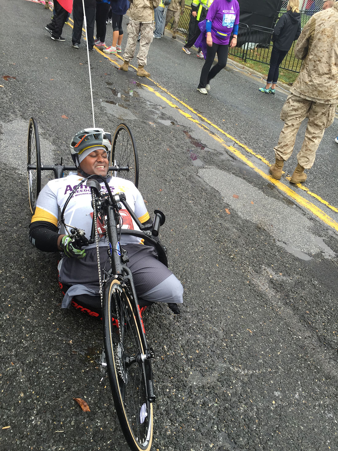 Injured Marine veteran rolls to finish line at Washington, DC, marathon