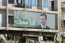 https://creativecommons.org/licenses/by/2.0/  Typical propaganda poster featuring Syrian president Bashar al-Assad. His image is all over the country (watchsmart/Creative Commons).