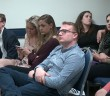 George Washington University students listen to a debate on healthcare and welfare