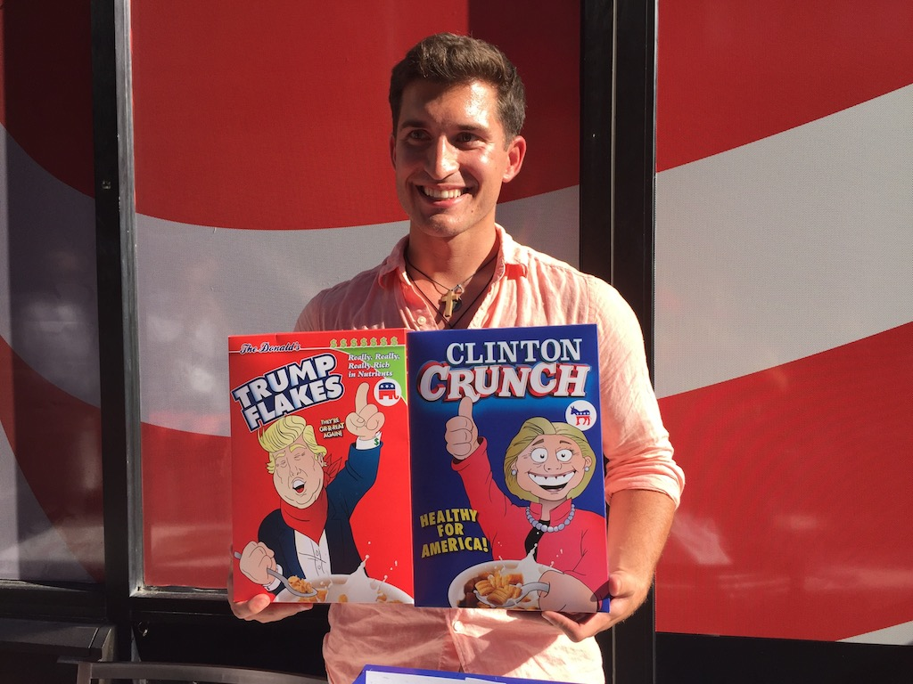 Darrin Maconi, 27, sells Trump Flakes and Clinton Crunch cereal at the RNC in Cleveland to help raise money for a friend's college tuition. (Michelle R. Martinelli)