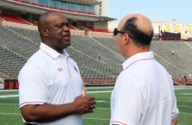 Defensive line coach Mike London, left, and special teams coordinator and tight ends coach Pete Lembo chat at Capital One Field at Maryland Stadium during the team's Media Day. (Michelle R. Martinelli)