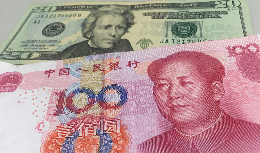 China will let yuan weaken further as dollar rises, analysts say