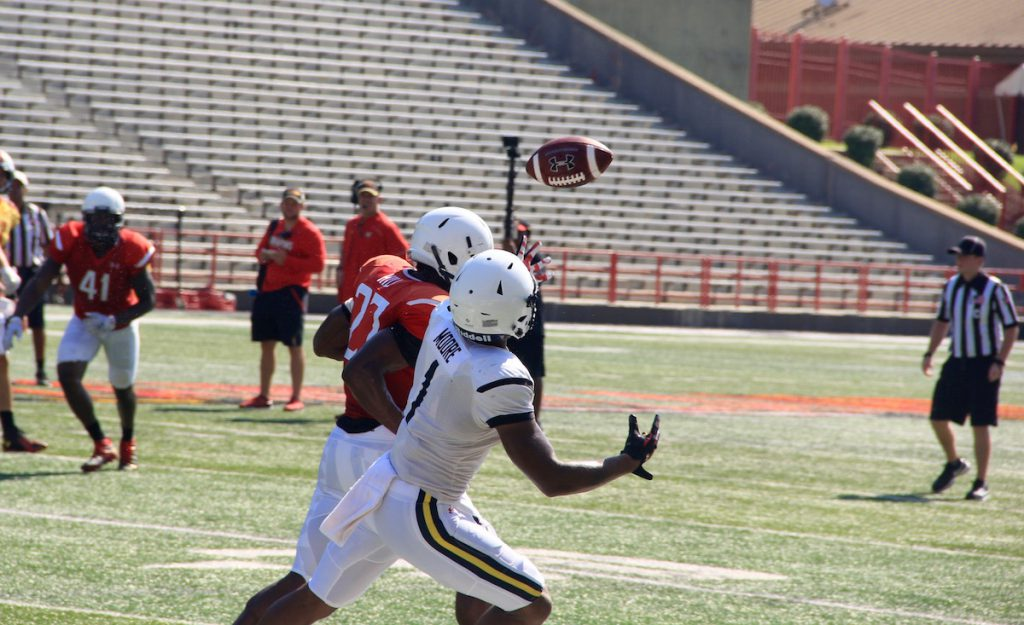 Senior defensive back Alvin Hill, left, and sophomore wide receiver D.J. Moore fight for the ball during a preseason scrimmage at Capital One Field at Maryland Stadium on Aug. 20. (Michelle R. Martinelli)