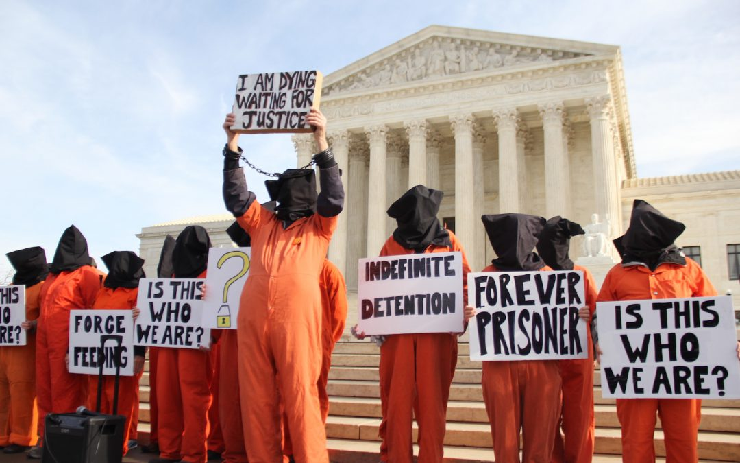 Guantanamo prison protesters criticize both Obama and Trump