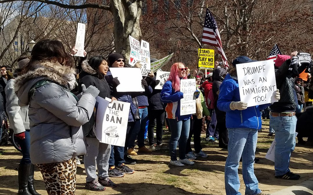 Demonstrators protest Trump travel ban despite frigid weather