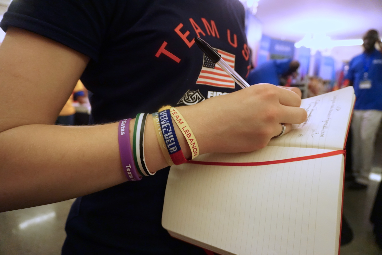 Katie Johnson of Team USA wears bracelets she's exchanged with the other teams from the competition. (Ritu Prasad/Medill News Service)