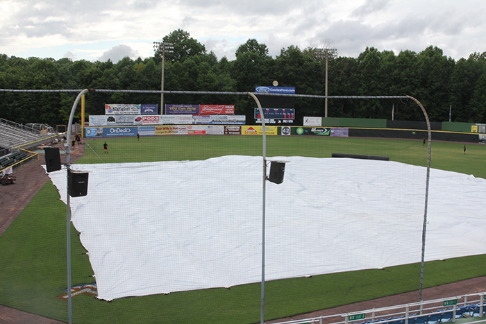 The grounds crew had to bring out the tarp due to the rain which caused back-to-back cancelled games for the Potomac Nationals