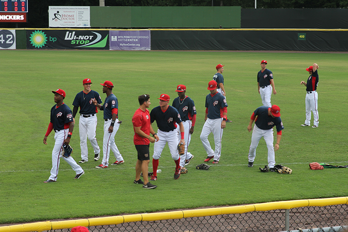 Potomac Nationals players warming up in right field before the first pitch.