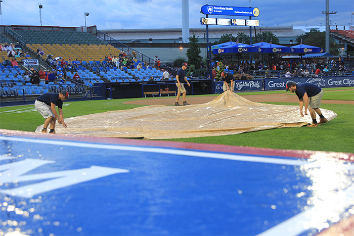 Uncovering home plate.