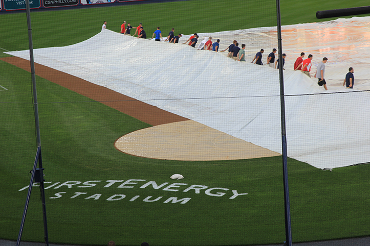 The grounds crew moving the tarp