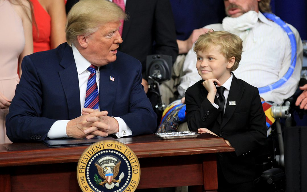 Trump signs 'right to try' bill, praises 8-year-old Indianapolis boy