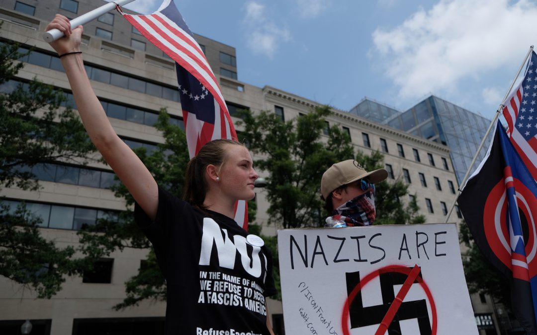 Two dozen white nationalists rally for Unite the Right, while more than 1,000 protested against them