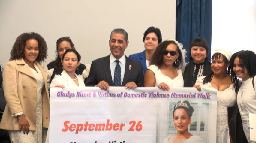 Brides march for domestic violence awareness