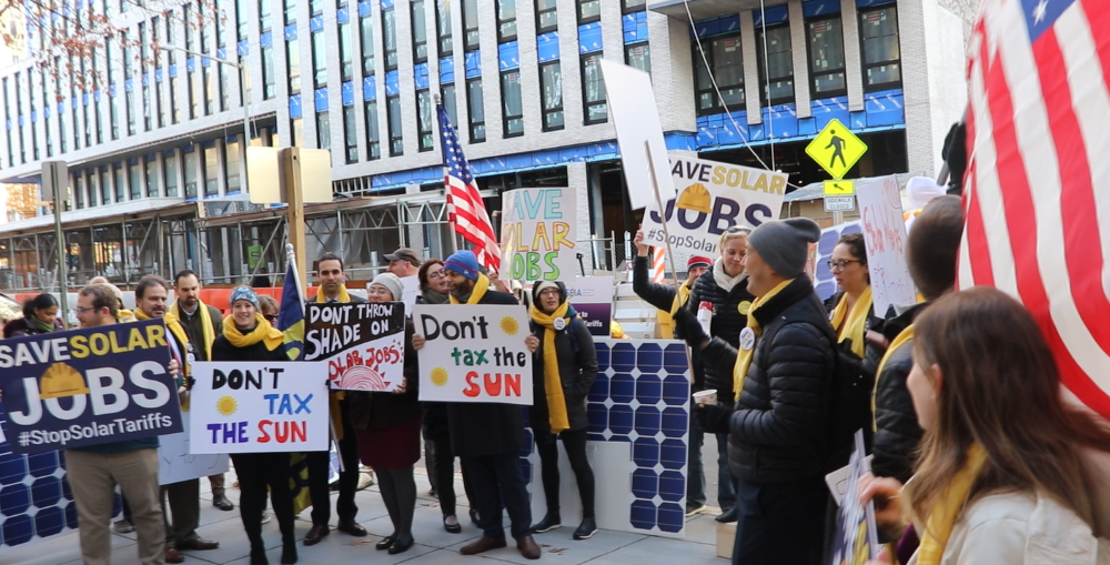 Protesters rally for an end to solar tariffs