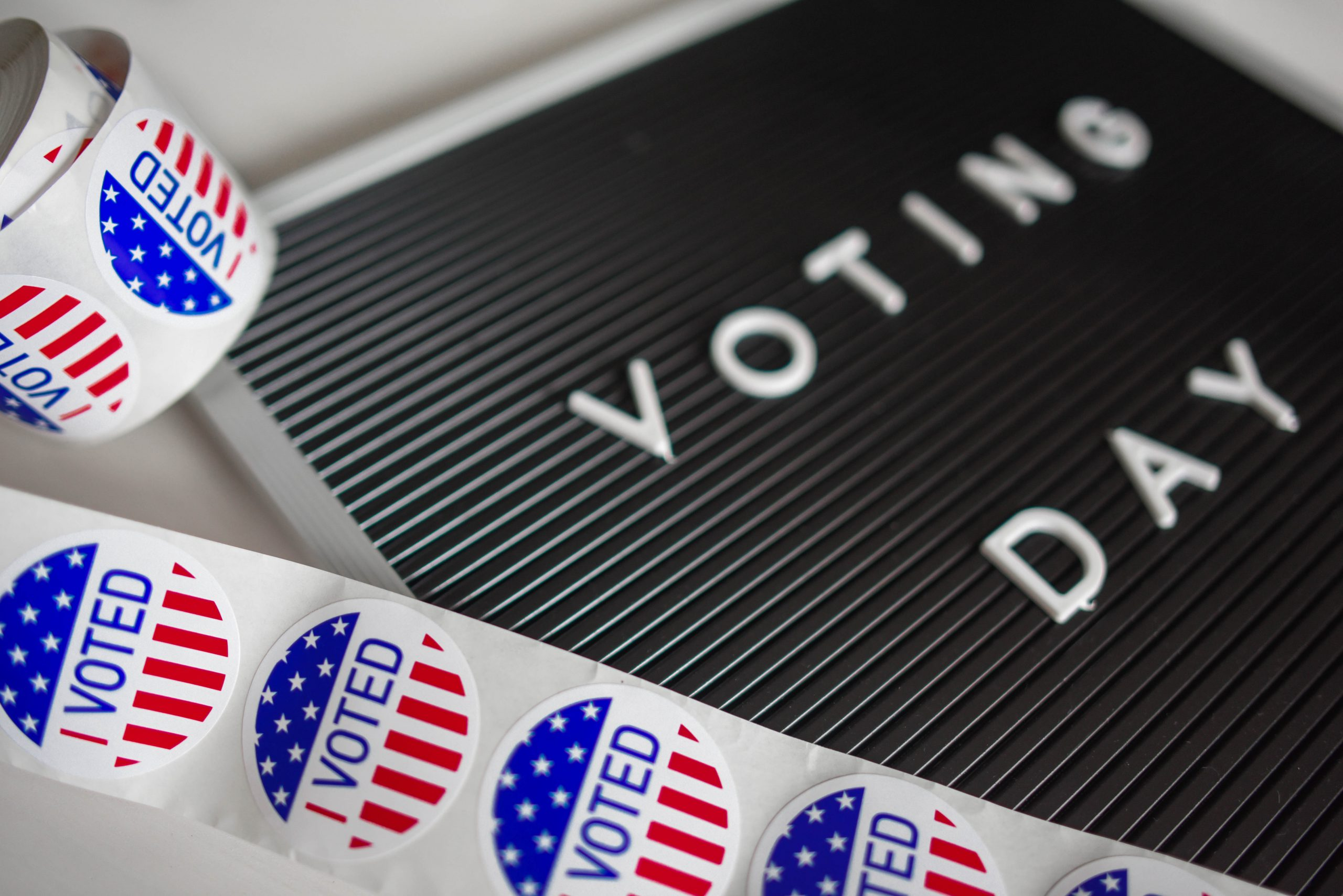 Voting sticker and sign