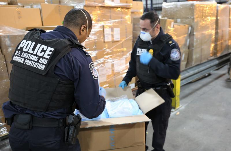 U.S. Customs officials struggling to prevent the overflow of counterfeit goods through mail