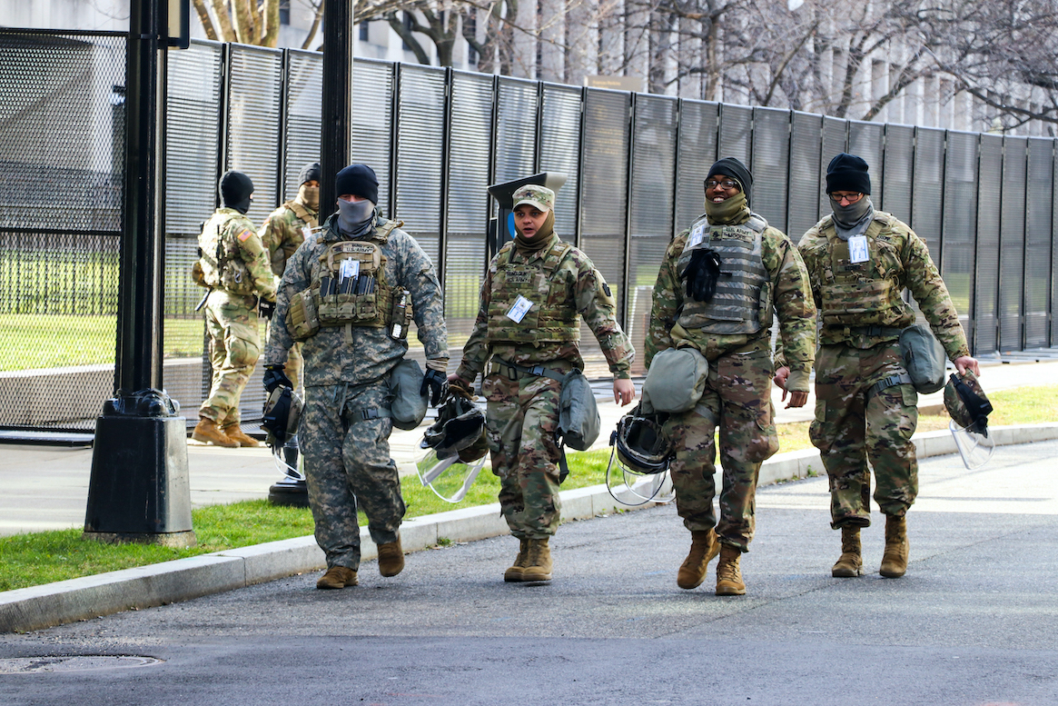 National Guard troops look relieved after Biden is sworn in as president